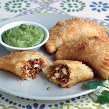 Chorizo and Cheese Empanadas with Avocado Crema