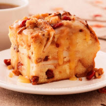 Praline Topped Apple Cranberry Bread Pudding with Butter Rum Sauce