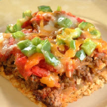 tortilla crust—topped with beef, cheese, and mild green chiles ...